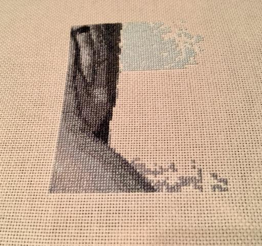 Cross stitching a photo.